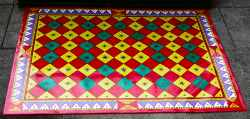 A colourful Oilcloth Rug lying on a floor.
